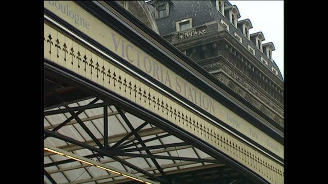 exterior shots of victoria rail station entrance & signs, and passengers walking past on january 6, 1989 in london, england. - train vehicle stock videos & royalty-free footage