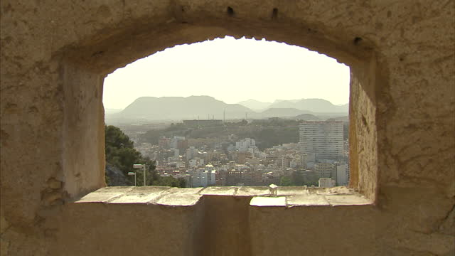 exterior shots of views from the castle of santa barbara on mount benacantil overlooking alicante>> on may 16 2015 in alicante spain - 見渡す点の映像素材/bロール