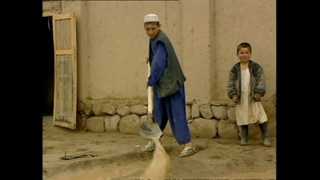 exterior shots of villagers in khuj a bahuddin clearing up after a rainstorm on october 27 2001 in kabul afghanistan - asian tribal culture stock videos and b-roll footage