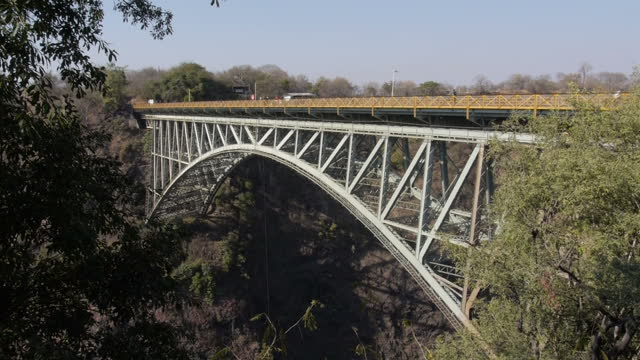 exterior shots of visitors stood on a bridge over victoria falls looking out over the zambezi on august 07 2015 in hwange zimbabwe - victoria falls stock videos and b-roll footage