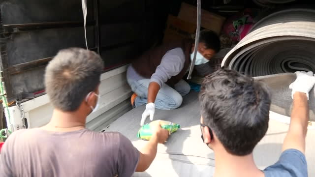 exterior shots of volunteers unloading aid from a truck after a major earthquake hit the area filmed on april 30 2015 in kathmandu nepal - major military rank stock videos and b-roll footage