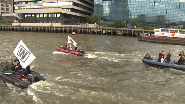 exterior shots of vote in campaign boats circling around fishing for leave campaign boat in the river thames shots of fishing vessels campaigning for... - 2016 european union referendum stock videos and b-roll footage