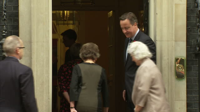 exterior shots of war widows outside number 10 downing street posing for photos with david cameron on november 08 2014 in london england - vedova video stock e b–roll