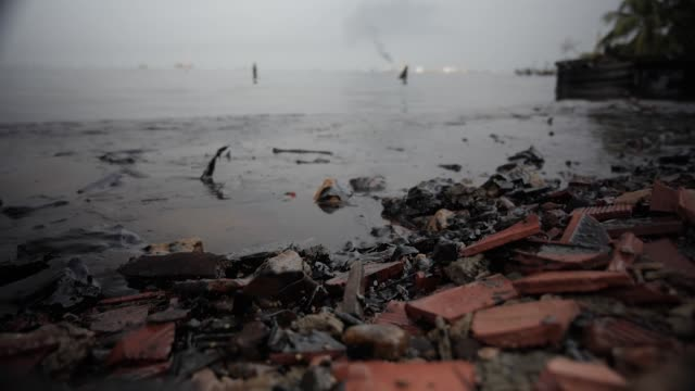 exterior shots of waste oil from leaky oilfield pipes washing onto shore and crude oil stuck to rocks at the maracaibo oilfields on 26 march 2019 in... - oil spill stock videos & royalty-free footage
