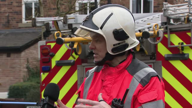 exterior shots of watch manager steve wilcock, from greater manchester fire and rescue service giving a statement regarding a house explosion,... - misfortune stock videos & royalty-free footage
