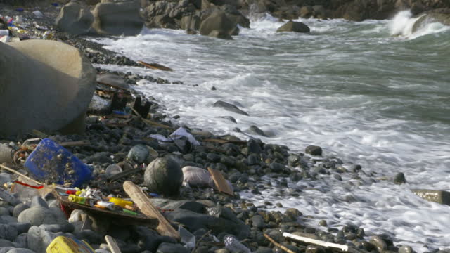 Exterior shots of waves crashing in to shore on a litter strewn beach in Hong Kong with more plastic waste being washed up on January 24 2017 in Hong...