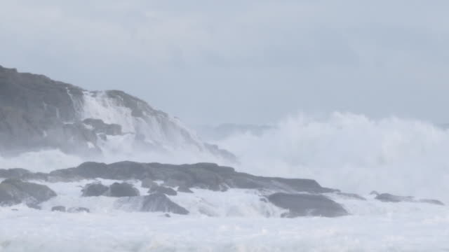 exterior shots of waves in a storm crashing onto beach and over granite rocks on 18 december 2018 in shetland united kingdom - granite stock videos & royalty-free footage