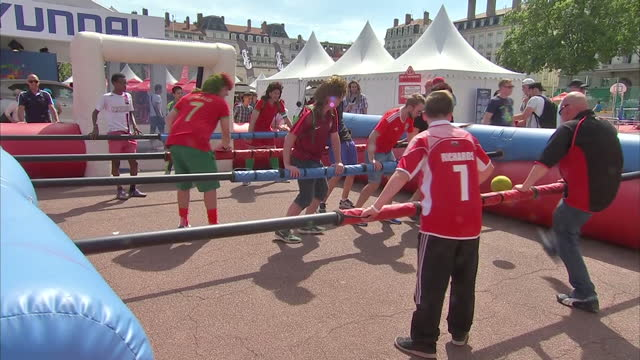 exterior shots of welsh and portuguese football fans celebrating in lyon prior to the two sides' clash during the euro 2016 championships on july 06... - olympique lyonnais stock videos and b-roll footage