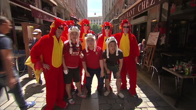 Exterior shots of Welsh football fans drinking and celebrating in Lyon in the run up to the Wales v Portugal semi final Euro 2016 match on July 06...