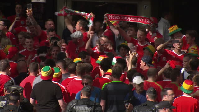 exterior shots of welsh football fans gathering and gendarmerie police force patrolling ahead of the euro 2016 match between wales & russia on june... - toulouse stock videos & royalty-free footage