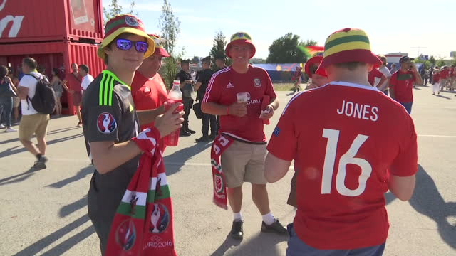 exterior shots of welsh football fans outside lyon stadium drinking and celebrating prior to their side's semi final on july 06 2016 in lyon france - parc olympique lyonnais stock videos and b-roll footage