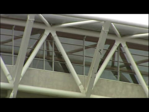 exterior shots of wembley stadium showing arch and signage. exterior shots showing inside of wembley stadium with groundsmen checking pitch and wide... - wembley stadium stock videos & royalty-free footage
