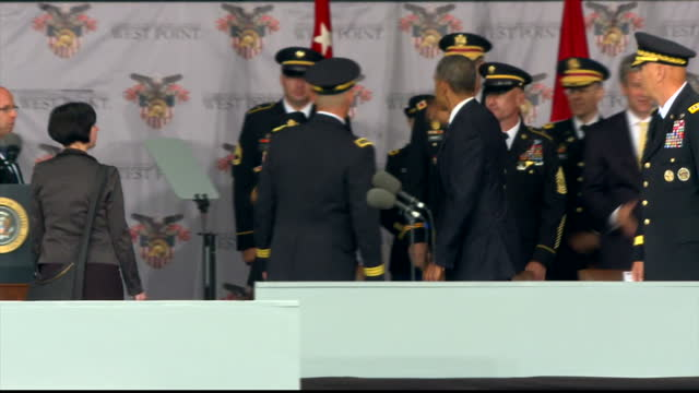 Exterior shots of West Point Military Academy 2014 Graduates throw their hats in the air on their graduation day celebrate after President Barack...