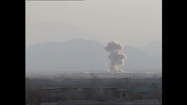 exterior shots of what appear to be us f18 hornet fighter jets carrying out air strikes against the taliban as seen from bagram airfield >> on... - operazione enduring freedom video stock e b–roll