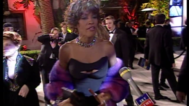 Exterior shots of Whitney Houston being interviewed on Vanity Fair red carpet and asked questions about the Oscars ceremony her dress Whitney Houston...
