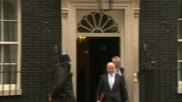 stockvideo's en b-roll-footage met exterior shots of william hague mp walking from number 10 downing street william hague mp departs downing street on march 06 2012 in london england - william hague