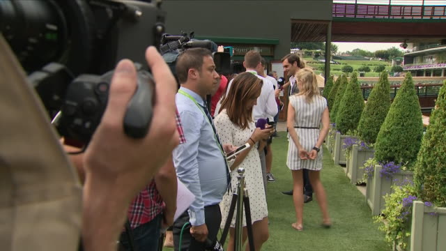 exterior shots of wimbledon tennis champion roger federer talking to the media, including panning, zoom and cameras in shot on 1 july 2018 in... - zoom in点の映像素材/bロール