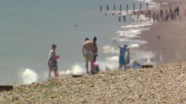 vídeos de stock e filmes b-roll de exterior shots of winchelsea beach after record number of migrant crossings were intercepted along the coastline on 01 june 2019 in east sussex... - east sussex