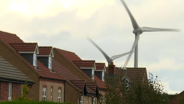 exterior shots of wind turbines in a farm field in northamptonshire and a new housing estate on 17 november 2020 in northampton, united kingdom - wind turbine stock videos & royalty-free footage