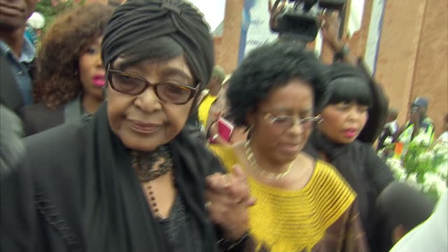 stockvideo's en b-roll-footage met exterior shots of winnie madikizela mandela departing a church service at bryanston methodist church during a national day of prayer for nelson... - gauteng provincie