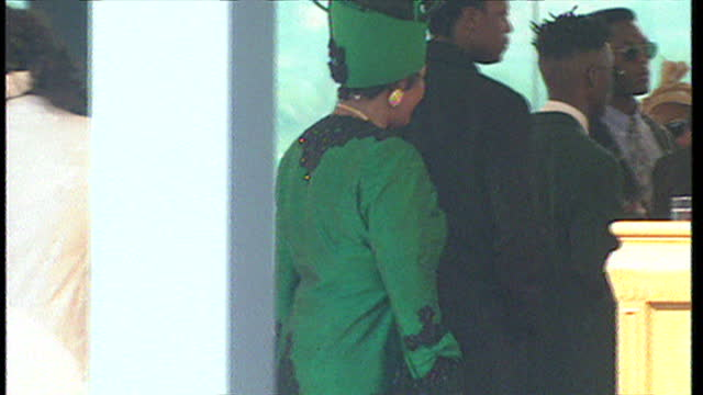 Exterior shots of Winnie Mandela hugging Archbishop Desmond Tutu at an ANC victory rally on May 02 1994 in Durban South Africa
