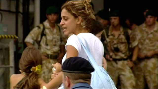 Exterior shots of women children and a few elderly men boarding HMS Bulwark in Beirut evacuating during the 2006 conflict on July 22 2006 in Beirut...