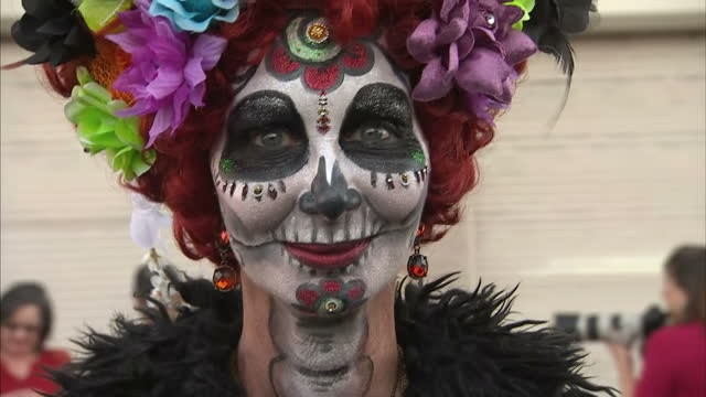 Exterior shots of women dressed in costume as decorated skeletons on November 7 2016 in Tucson Arizona United States