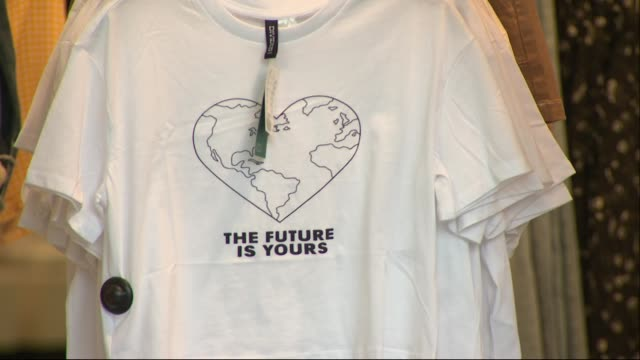 exterior shots of women's clothing on display in the window of a branch of hm on oxford street including tshirts reading 'the future is yours'... - sustainable resources stock videos & royalty-free footage