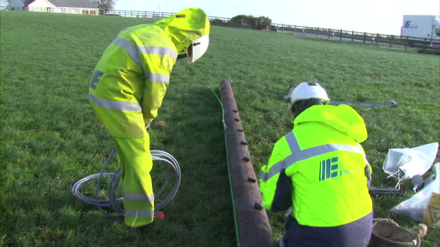 exterior shots of workers preparing to replace an electricity pylon after power lines were blown down in high winds near the town of newtownards in... - 2013 stock videos & royalty-free footage