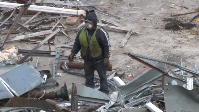 exterior shots of workers rummaging through construction debris searching for materials that have to be disposed of separately from other debris... - toxic waste stock videos & royalty-free footage