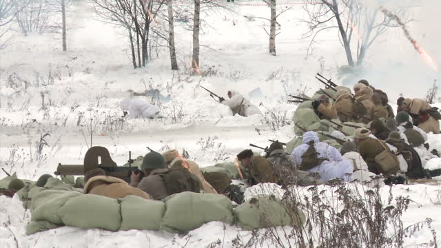 exterior shots of world war two enthusiasts in period military uniforms of the soviet and german forces taking part in a reconstruction of a ww2... - historische nachstellung stock-videos und b-roll-filmmaterial