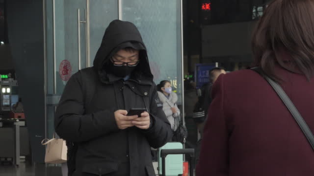 exterior shots of wuhan railway station and commuters wearing masks on 24 january 2020 in wuhan china - station stock videos & royalty-free footage