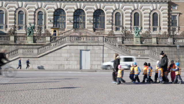 exterior shots of yachts and river cruisers moored on stockholms ström and a group of school children outside parliament house on 3 april 2020 in... - sweden stock-videos und b-roll-filmmaterial