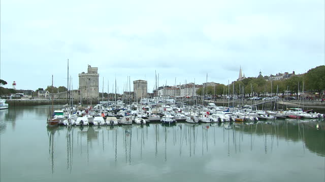 Exterior shots of yachts moored in La Rochelle old harbour and tourists and locals walking around its historic city centre on 31 October 2017 in La...