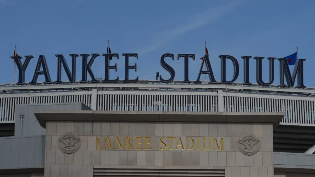 Exterior shots of Yankee Stadium during the day in Bronx New York Close up shots of the Yankee Stadium sign on top of the building in Bronx New York...
