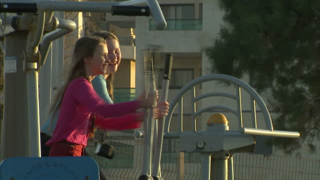 exterior shots of young children playing on outdoor play equipment on march 16 2013 in national harbor maryland - ashkelon stock videos and b-roll footage