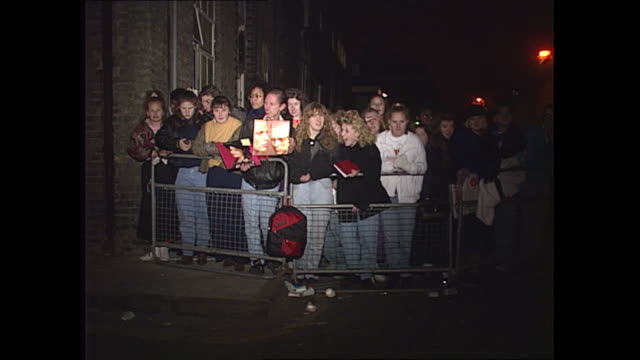 exterior shots of young girls fans of various recording artists waiting outside recording studio as the recording of 1989's 'band aid' charity single... - pop music stock-videos und b-roll-filmmaterial