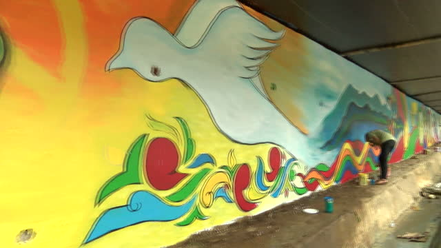 Exterior shots of young women painting a peace mural along a wall on October 31 2017 in Marawi City Philippines