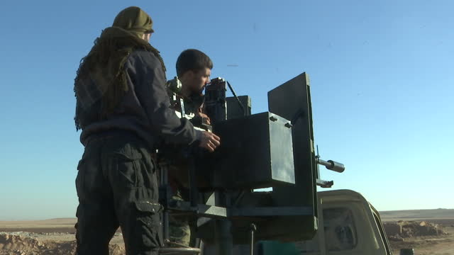 exterior shots of ypg fighters checking and loading ammunition into a machine gun on the back of an improvised fighting vehicle near ayn issa.>> on... - people's protection units stock videos & royalty-free footage