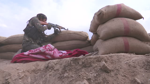 exterior shots of ypg fighters looking out over a parapet of sandbags on the front line near ayn issa.>> on december 15, 2015 in ain issa, syria. - 2015 stock videos & royalty-free footage