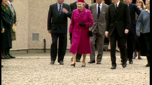 stockvideo's en b-roll-footage met exterior shots of zara phillips and her brother peter phillips walking with queen elizabeth and prince philip during their visit to gordonstoun... - 1995