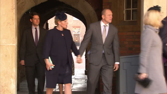 Exterior shots of Zara Phillips and Mike Tindall arriving at Christening and shaking peoples hands before entering building Zara Phillips Mike...