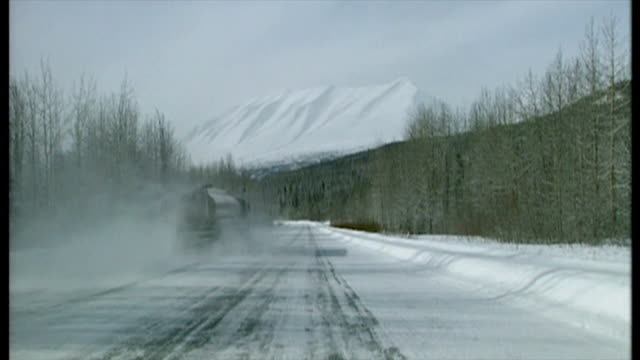 exterior shots oil works pipelines steam coming out of chimney and alaska landscape countryside on march 21 1999 in cordova alaska - landscape scenery点の映像素材/bロール