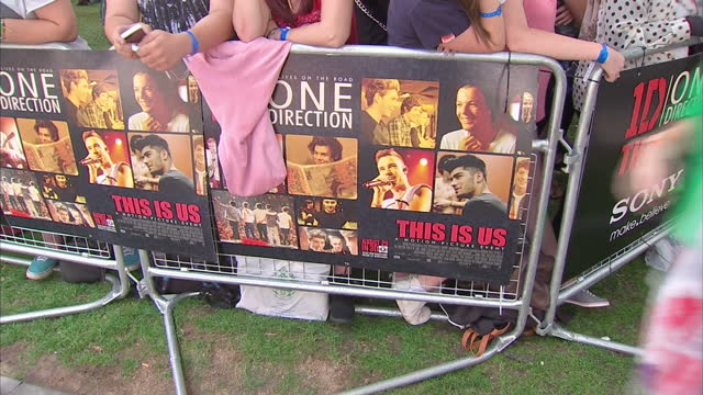 exterior shots one direction fans cheering screaming with shots of film posters one direction fans at film premiere on august 20 2013 in london... - music poster stock videos & royalty-free footage