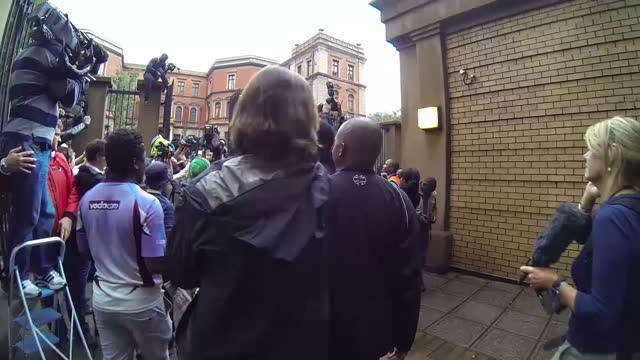 exterior shots oscar pistorius departing court surrounded by cameras on march 04 2014 in pretoria south africa - オスカー・ピストリウス点の映像素材/bロール