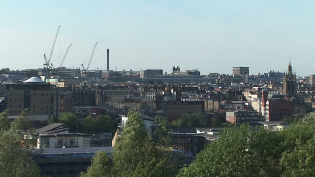 exterior shots over newcastle's cityscape including the church of st thomas the martyr trains passing and various high rise buildings on 10 august... - newcastle upon tyne stock videos and b-roll footage