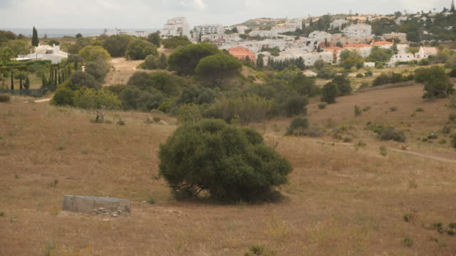 exterior shots over rooftops of rural houses and a hillside near praia da luz, where madeleine mccann suspect christian b is reported to have lived... - madeleine mccann stock videos & royalty-free footage