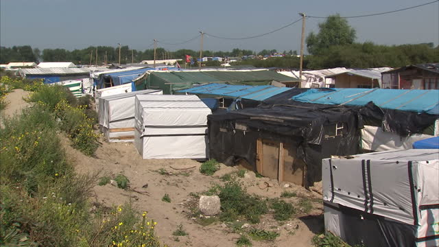 exterior shots over the rooftops of the sprawling calais jungle migrant camp with various makeshift dwellings and structures on august 30 2016 in... - makeshift stock videos and b-roll footage