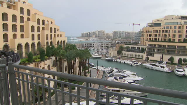 stockvideo's en b-roll-footage met exterior shots over valetta harbour with yachts moored and waves crashing into the shore on 4 october 2017 in valetta malta - valletta
