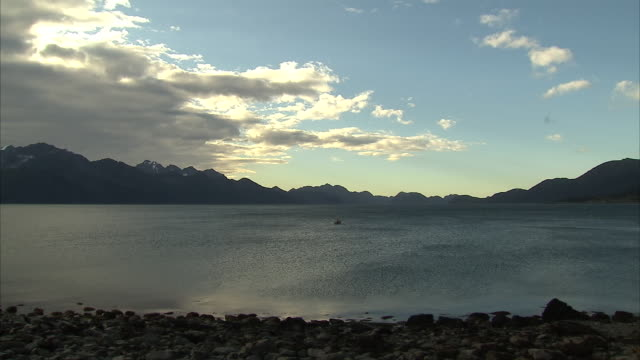 exterior shots overlooking the gulf of alaska and the partially snow-covered mountains of the kenai peninsula, and close-ups of two fishermen fishing... - kenai peninsula stock videos & royalty-free footage